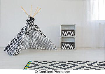 Cozy room for a baby with teepee