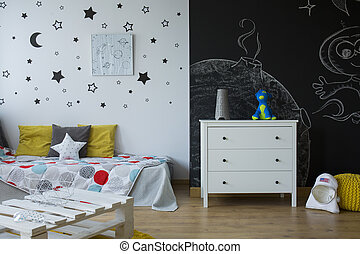 Child room with commode, bed and black wall