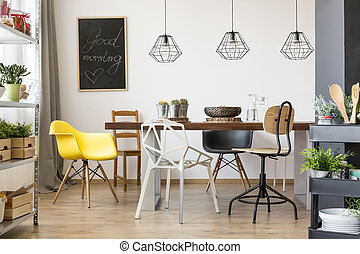 Table in spacious dining room - Communal table in bright and...