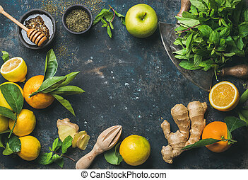 Oranges, mint, lemons, ginger, honey, apple, spices over...