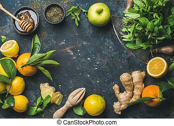 Oranges, mint, lemons, ginger, honey, apple, spices over...