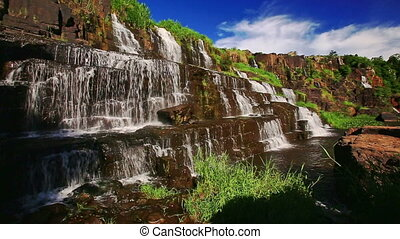 View of Wide Waterfall Pongour among Rocks in Vietnam -...