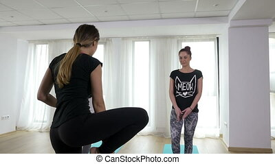 Three girls doing warm up before yoga practice