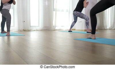 Group of woman doing yoga class indoor