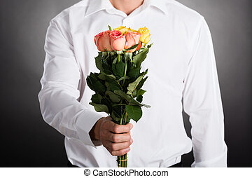 Man Giving Roses - Close-up Of A Man Giving Bunch Of Roses...
