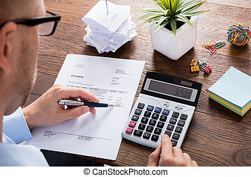 Person Calculating Tax - Accountant Or Financial Advisor...