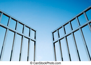 iron gate open to the sky, concept of freedom