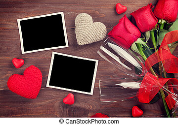 Valentines day photo frames, champagne and red roses on...