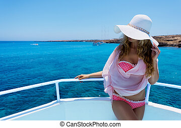 Woman enjoying a sunny summer day - Girl on a yacht. Woman...