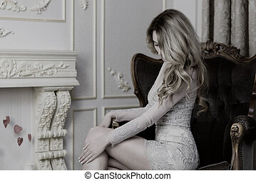 Blonde Lady in a Delicate Lace Dress sitting in a chair....