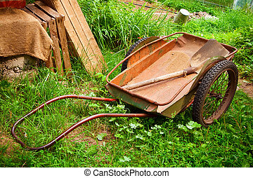 Old Wagon And Spade - an old wagon and a spade in it,...
