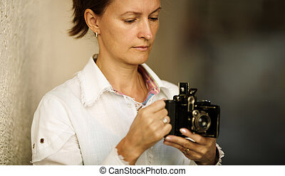 photo hobby - Woman with camera ,focus point on eye