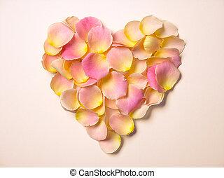 rose petals heart shape on beige paper background