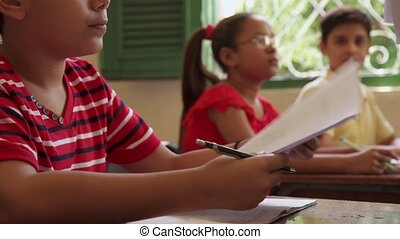 Test And Education Students In Class At School - Young...
