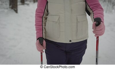 People who engaged in Nordic walking in the winter forest...