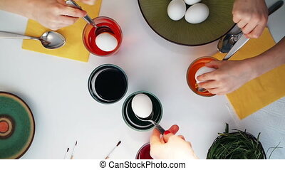 Children painting Easter eggs. Top view - Happy easter! A...