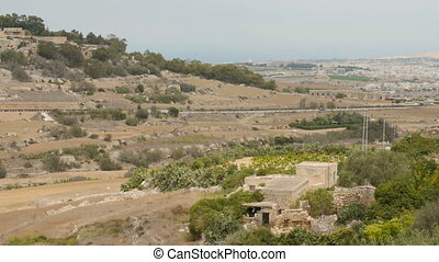 Hilly landscape of colourful agricultural land of Malta island.