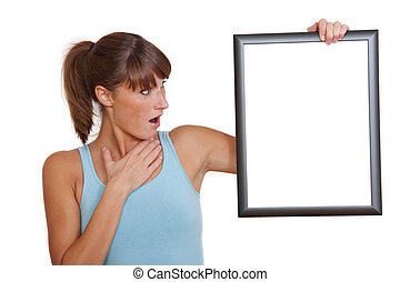 surprised woman with picture frame
