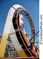 Rollercoaster at funfair - Fast rollercoaster at funfair in...