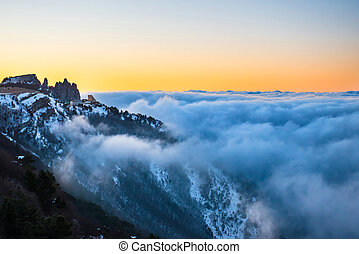 Sunset in mountains with clouds