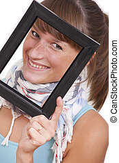 woman looking through photo frame