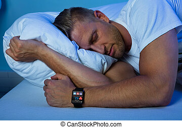 Man Sleeping With Smart Watch In His Hand Showing Heartbeat...