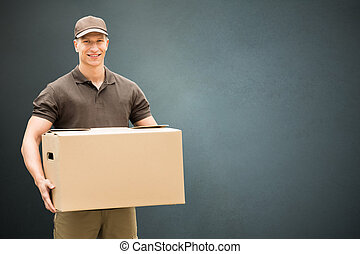 Delivery Man Holding Cardboard Box - Portrait Of A Young...