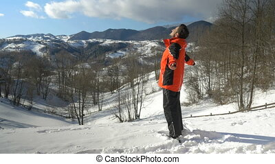 Adult man enjoying a beautiful day at the mountains in winter