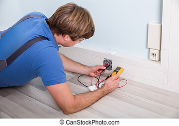 Electrician Checking Socket Voltage