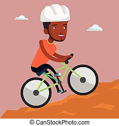 Young man on bicycle traveling in the mountains.