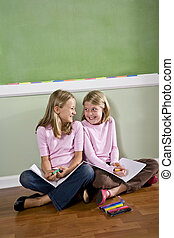 Friends doing homework together - Back to school - two 8...