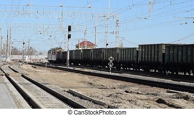 Locomotive with freight cars. Railway. The rails and...