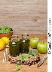Green fresh leafy greens smoothie in glass jar, spinach...