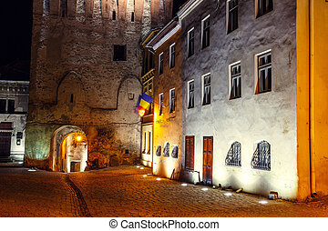 Night view of historic town Sighisoara, Romania. City in...