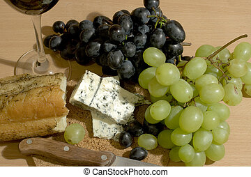 Simple taste of life - Bread, cheese and grapes with a glass...