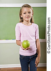 Student with apple for teacher - Back to school - 8 year old...