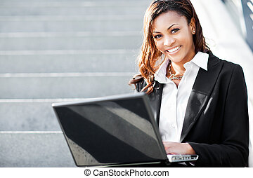 Black businesswoman with laptop - A shot of a beautiful...