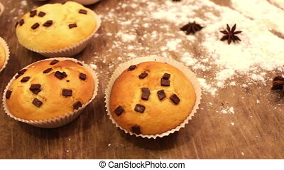Freshly baked muffins with chocolate rosy slices sprinkled...