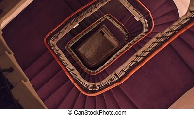 Steadicam shot of old building staircase, view from above.