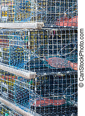 Lobster Pots Stacked - Many lobster pors are stacked on top...