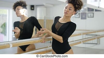 Attractive dedicated young dancer practicing