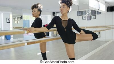 Pretty and sexy female dancer in studio