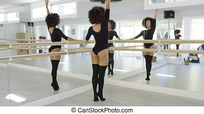 Multiple reflections of a young dancer in the mirrors...