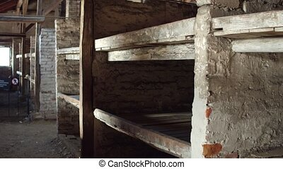 Plank beds in a concentration camp. 4K steadicam shot -...