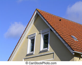 Attic with red tile roof - Attic on typical brick house,...