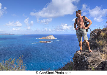 Hiker on top of mountain in Hawaii - Muscular shirtless...