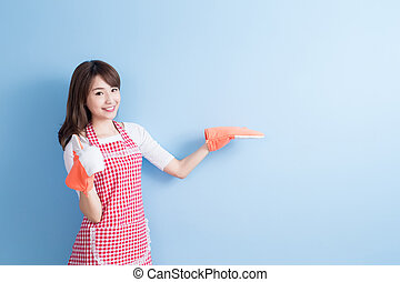 beauty housewife thumb up and wear gloves isolated on blue...