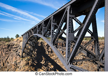 Magnificent arched tracery transport bridge in deserted...