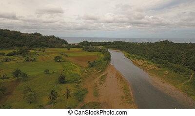 Mountain river flows into the sea..Camiguin island...