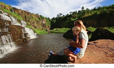 Mother Sits Holds on Knees Little Girl Makes Selfie by...